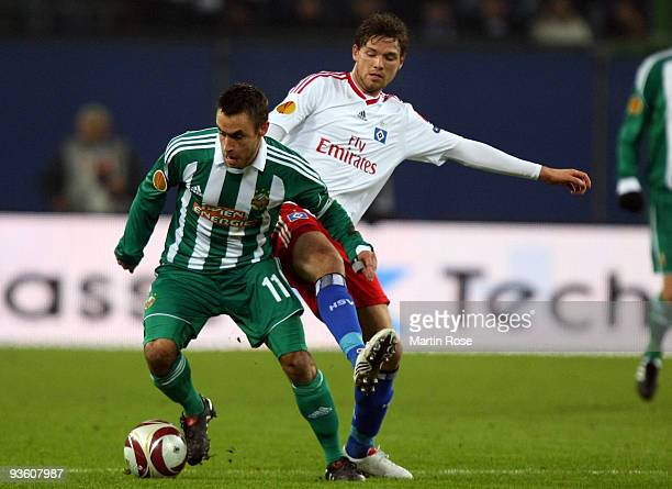 Marcus Berg of Hamburg and Steffen Hofmann of Wien compete for the ball during the UEFA Europa League Group C match between Hamburger SV and SK Rapid...