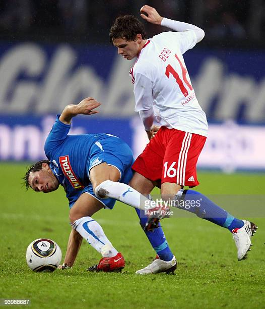 Marcus Berg of Hamburg and Tobias Weis of Hoffenheim battle for the ball during the Bundesliga match between Hamburger SV and 1899 Hoffenheim at the...