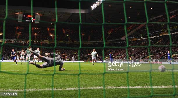 Marcus Berg of Hamburger SV scores past a diving goalkeeper Artur Boruc of Celtic during the UEFA Europa League Group C match between Celtic and...