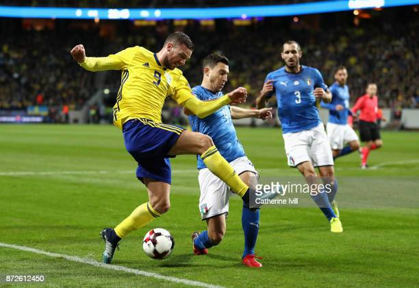 Marcus Berg of Sweden and Matteo Darmian of Italy battle for possession during the FIFA 2018 World Cup Qualifier PlayOff First Leg between Sweden and...
