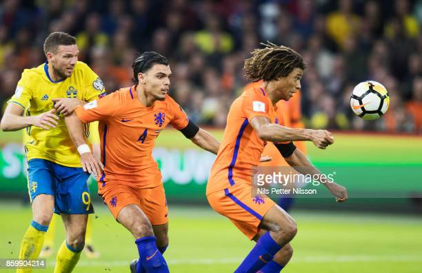 Marcus Berg of Sweden Karim Rekik of Netherlands and Nathan Aké of Netherlands competes for the ball during the FIFA 2018 World Cup Qualifier between...