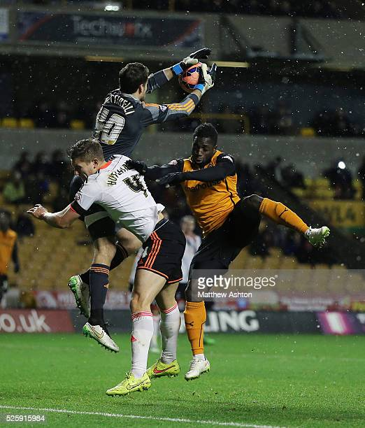 Marcus Bettinelli of Fulham and Nouha Dicko of Wolverhampton Wanderers