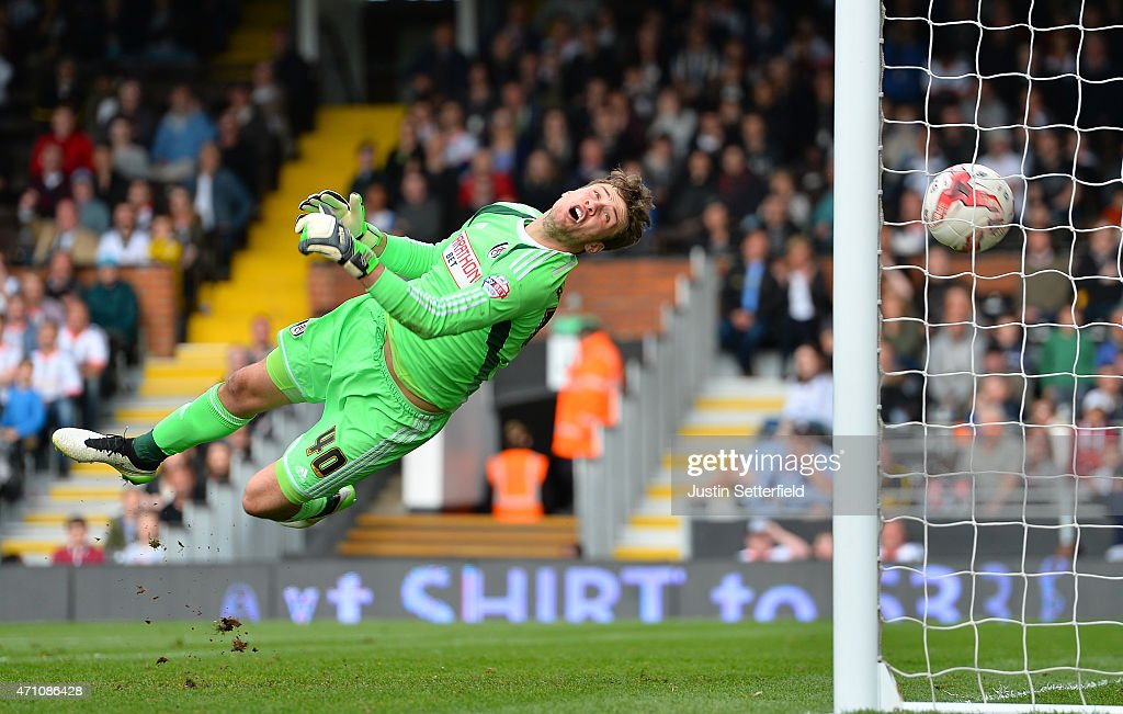 Marcus Bettinelli of Fulham FC is unable to save Middlesbrough's 3rd goal scored by Kike (not pictured) during the Sky Bet Championship match between Fulham and Middlesbrough at Craven Cottage on April 25, 2015 in London, England.