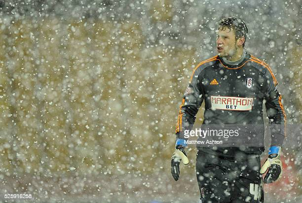 Marcus Bettinelli of Fulham stands in the snow