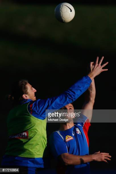 Marcus Bontempelli and Tom Liberatore compete for the ball during a Western Bulldogs AFL training session at Whitten Oval on July 18 2017 in...