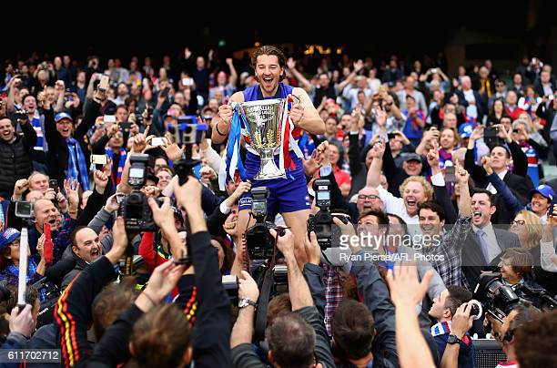 Marcus Bontempelli of the Bulldogs celebrate with the Premiership Cup after the 2016 Toyota AFL Grand Final match between the Sydney Swans and the...