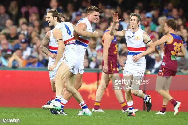Marcus Bontempelli of the Bulldogs celebrates a goal during the round 20 AFL match between the Brisbane Lions and the Western Bulldogs at The Gabba...