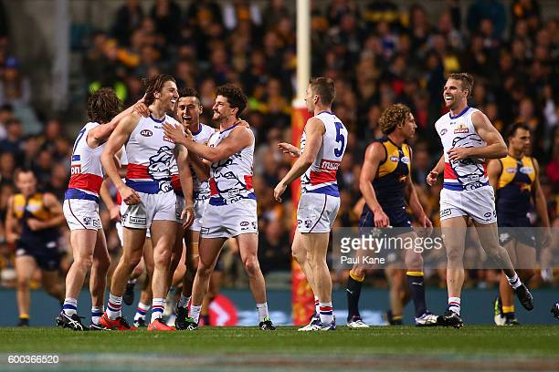 Marcus Bontempelli of the Bulldogs celebrates a goal with team mates during the Second Elimination Final match between the West Coast Eagles and the...