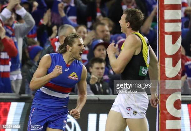 Marcus Bontempelli of the Bulldogs celebrates after kicking a goal during the round seven AFL match between the Western Bulldogs and the Richmond...