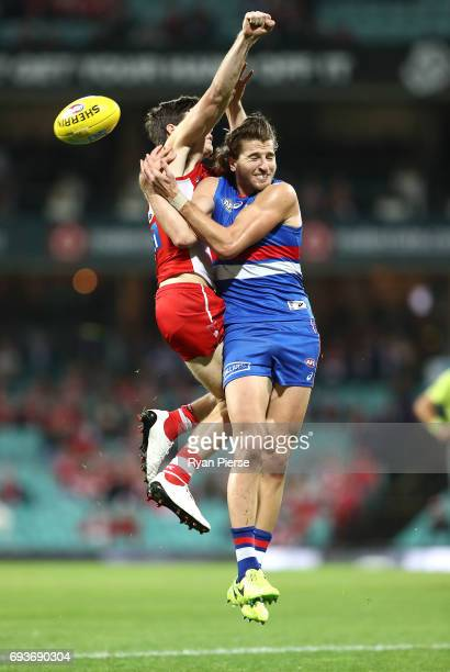 Marcus Bontempelli of the Bulldogs competes for the ball against George Hewett of the Swans during the round 12 AFL match between the Sydney Swans...