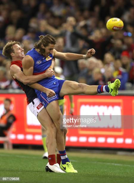 Marcus Bontempelli of the Bulldogs gets his kick away during the round 13 AFL match between the Western Bulldogs and the Melbourne Demons at Etihad...