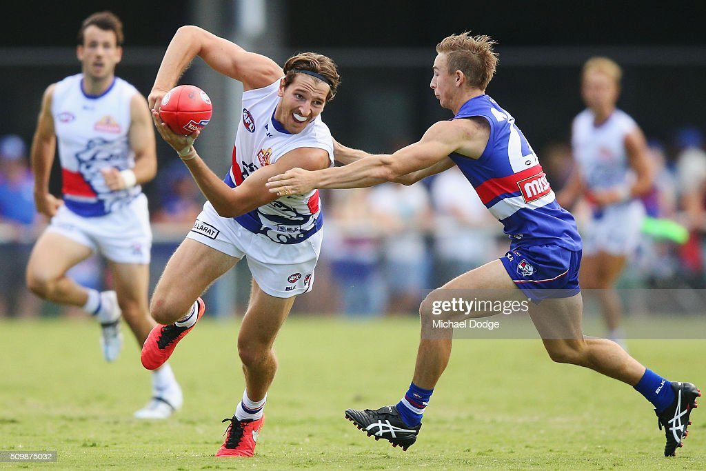 Marcus Bontempelli of the Bulldogs handballs away from Mitch Honeychurch of the Bulldogs during the Western Bulldogs AFL intra-club match at Whitten Oval on February 13, 2016 in Melbourne, Australia.