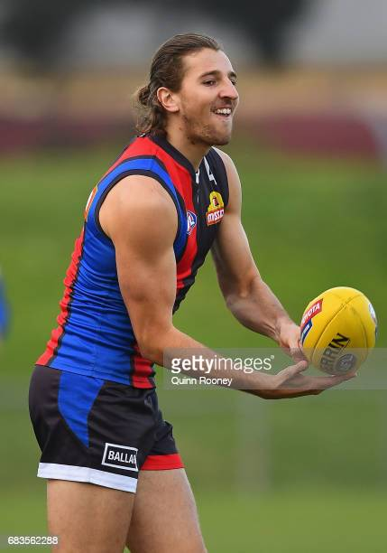Marcus Bontempelli of the Bulldogs handballs during a Western Bulldogs AFL training session at Whitten Oval on May 16 2017 in Melbourne Australia