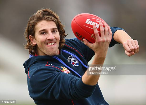 Marcus Bontempelli of the Bulldogs handballs during a Western Bulldogs training session at Whitten Oval on July 3 2015 in Melbourne Australia