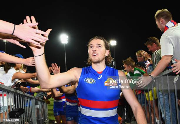 Marcus Bontempelli of the Bulldogs high fives fans after winning the round 18 AFL match between the Western Bulldogs and the Gold Coast Suns at...