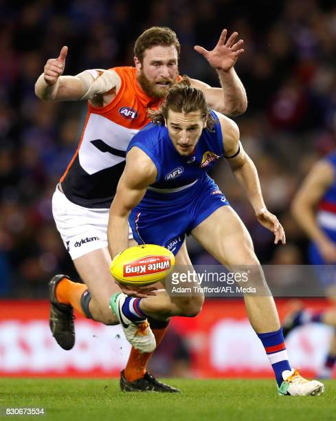 Marcus Bontempelli of the Bulldogs is tackled by Dawson Simpson of the Giants during the 2017 AFL round 21 match between the Western Bulldogs and the...