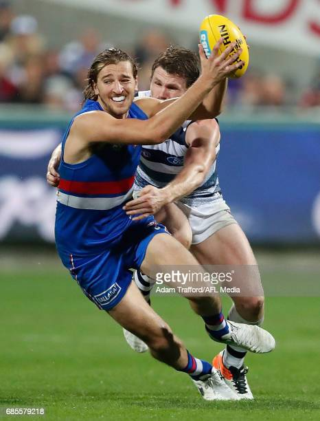Marcus Bontempelli of the Bulldogs is tackled by Patrick Dangerfield of the Cats during the 2017 AFL round 09 match between the Geelong Cats and the...
