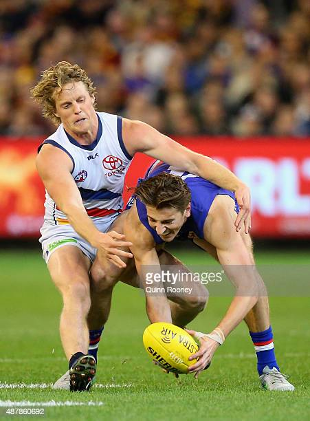 Marcus Bontempelli of the Bulldogs is tackled by Rory Sloane of the Crows during the AFL Second Elimination Final match between the Western Bulldogs...