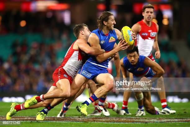 Marcus Bontempelli of the Bulldogs is tackled during the round 12 AFL match between the Sydney Swans and the Western Bulldogs at Sydney Cricket...