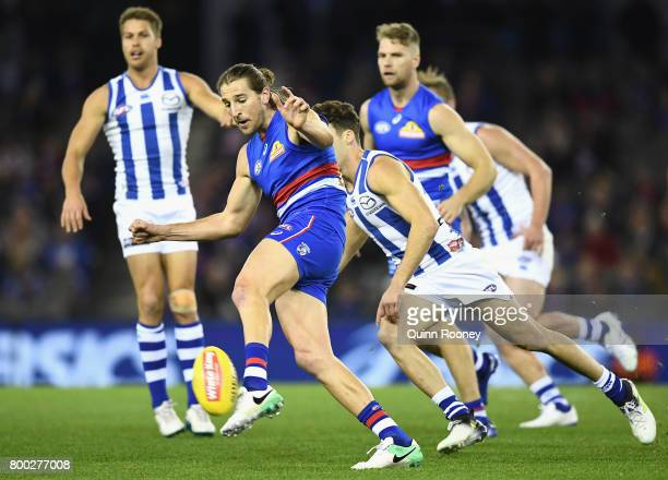 Marcus Bontempelli of the Bulldogs kicks during the round 14 AFL match between the Western Bulldogs and the North Melbourne Kangaroos at Etihad...