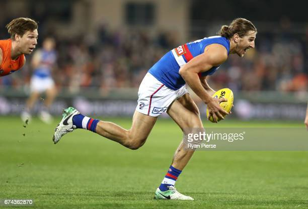 Marcus Bontempelli of the Bulldogs looks upfield during the round six AFL match between the Greater Western Sydney Giants and the Western Bulldogs at...