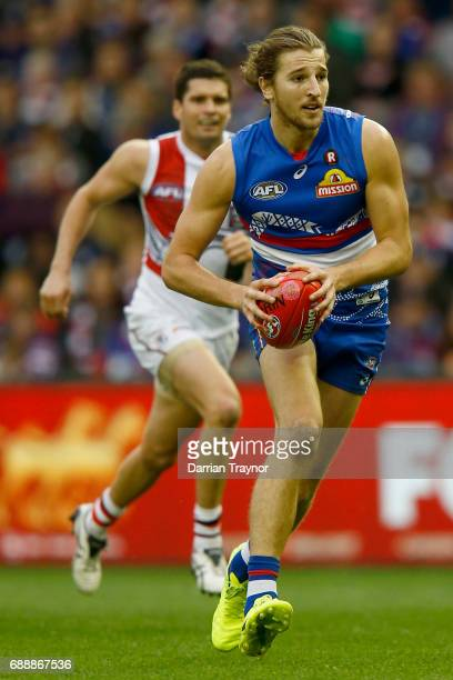 Marcus Bontempelli of the Bulldogs runs with the ball during the round 10 AFL match between the Western Bulldogs and the St Kilda Saints at Etihad...