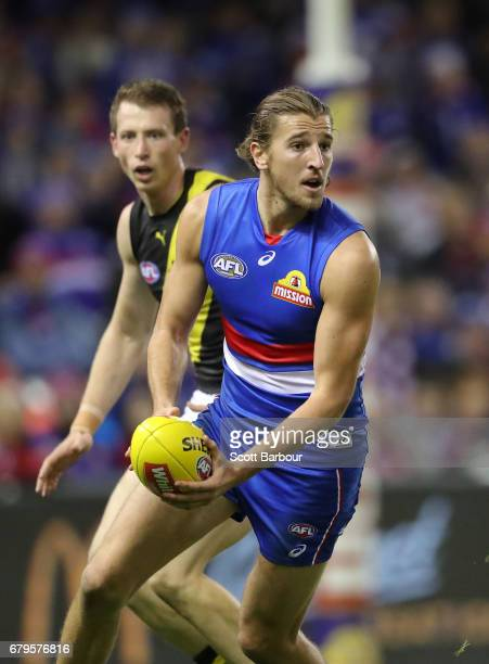 Marcus Bontempelli of the Bulldogs runs with the ball during the round seven AFL match between the Western Bulldogs and the Richmond Tigers at Etihad...