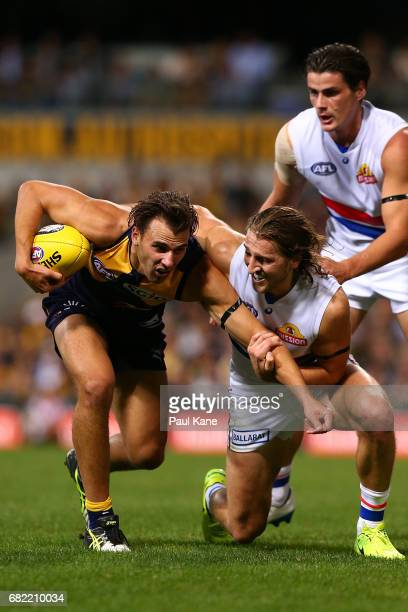 Marcus Bontempelli of the Bulldogs tackles Dom Sheed of the Eagles during the round eight AFL match between the West Coast Eagles and the Western...