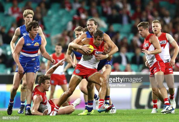 Marcus Bontempelli of the Bulldogs tackles Josh Kennedy of the Swansduring the round 12 AFL match between the Sydney Swans and the Western Bulldogs...
