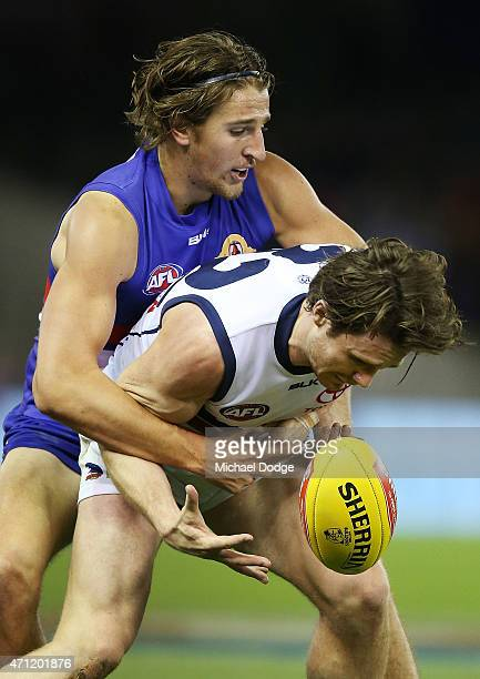 Marcus Bontempelli of the Bulldogs tackles Patrick Dangerfield of the Crows during the round four AFL match between the Western Bulldogs and the...