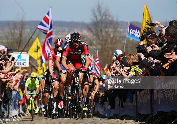 Marcus Burghardt of Germany and BMC Racing leads the Peloton up the Oude Kwaremont during the 100th edition of the Tour of Flanders from Bruges to...