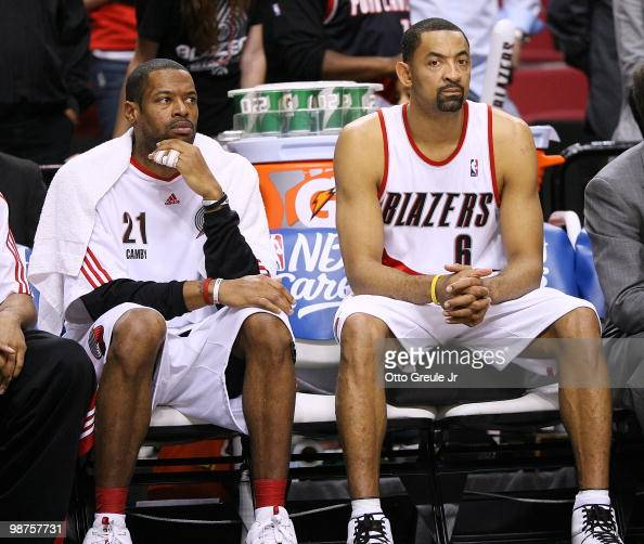 Marcus Camby and Juwan Howard of the Portland Trail Blazers sit on the bench as time runs out against the Phoenix Suns during Game Six of the Western...