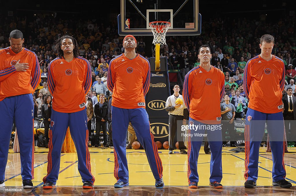 Marcus Camby #23, Chris Copeland #14, Kenyon Martin #3, Pablo Prigioni #9 and Steve Novak #16 of the New York Knicks during the national anthem prior to the game against the Golden State Warriors on March 11, 2013 at Oracle Arena in Oakland, California.