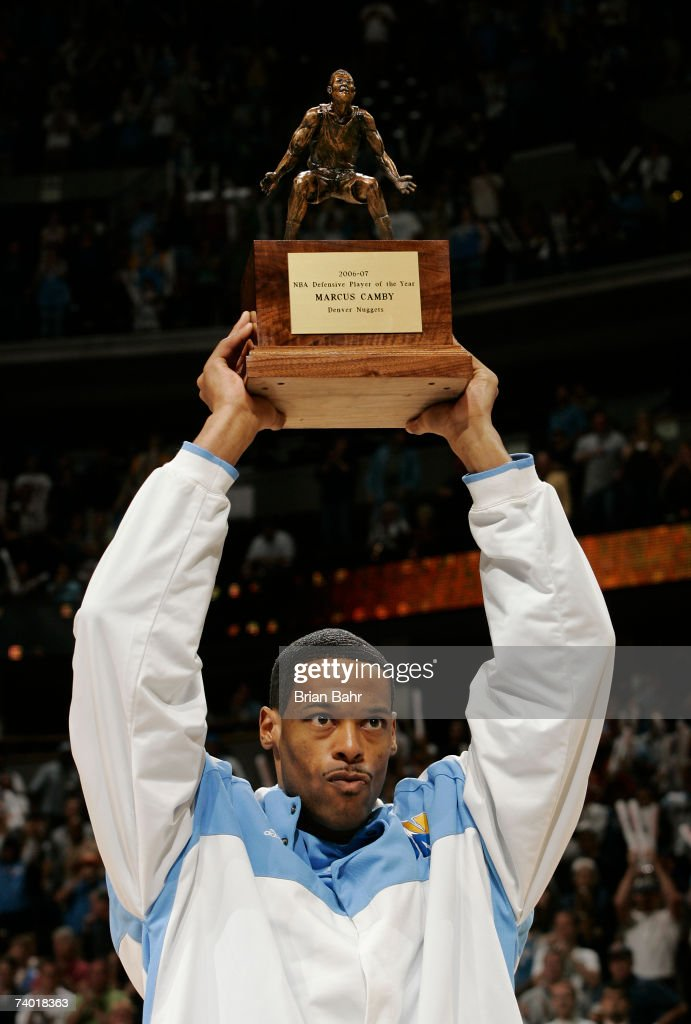 Marcus Camby of the Denver Nuggets accepts the NBA Defensive Player of the Year Award before taking on the San Antonio Spurs in Game Three of the Western Conference Quarterfinals during the 2007 NBA Playoffs at the Pepsi Center on April 28, 2007 in Denver, Colorado.