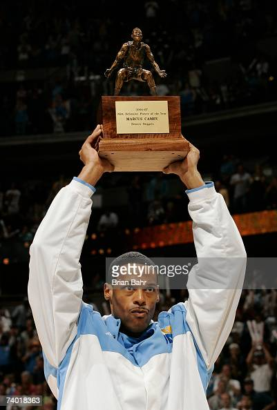 Marcus Camby of the Denver Nuggets accepts the NBA Defensive Player of the Year Award before taking on the San Antonio Spurs in Game Three of the...