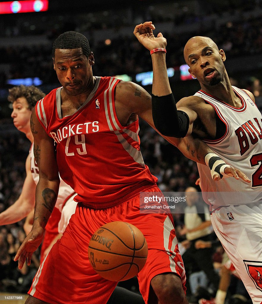 Marcus Camby #29 of the Houston Rockets and Taj Gibson #22 of the Chicago Bulls battle for the ball at the United Center on April 2, 2012 in Chicago, Illinois. The Rockets defeated the Bulls 99-93.