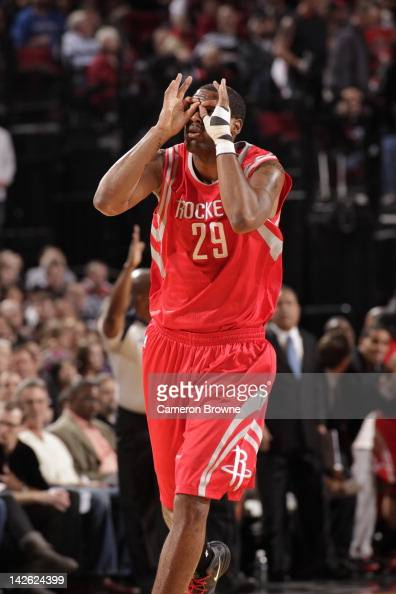 Marcus Camby of the Houston Rockets celebrates hitting a three point shot against the Portland Trail Blazers on April 9 2012 at the Rose Garden Arena...