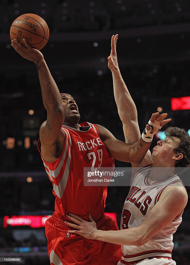 Marcus Camby #29 of the Houston Rockets shoots against Omer Asik #3 of the Chicago Bulls at the United Center on April 2, 2012 in Chicago, Illinois.