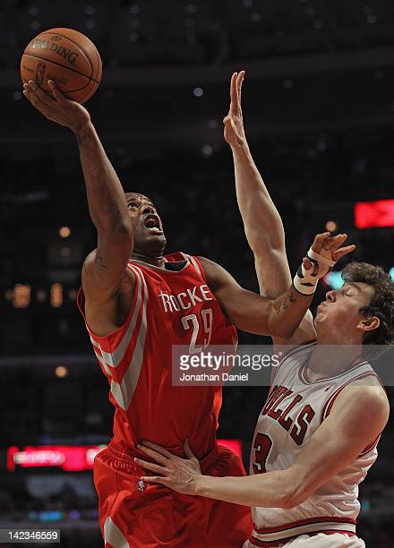 Marcus Camby of the Houston Rockets shoots against Omer Asik of the Chicago Bulls at the United Center on April 2 2012 in Chicago Illinois NOTE TO...