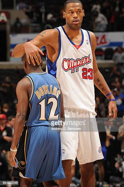 Marcus Camby of the Los Angeles Clippers and Earl Boykins of the Washington Wizards exchange greetings following their game at Staples Center on...