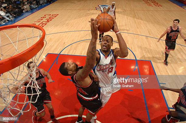 Marcus Camby of the Los Angeles Clippers goes up for a shot against Tyrus Thomas of the Chicago Bulls at Staples Center on January 20 2010 in Los...