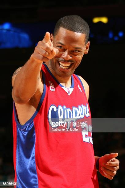 Marcus Camby of the Los Angeles Clippers points as he looks on with a smile during the game against the New York Knicks at Madison Square Garden on...