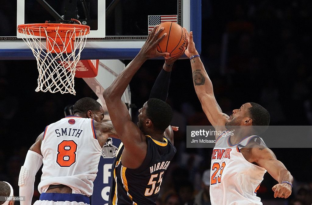 Marcus Camby #23 of the New York Knicks blocks a shot from Roy Hibbert #55 of the Indiana Pacers at Madison Square Garden on November 18, 2012 in New York City. The Knicks defeated the Pacers 88-76.
