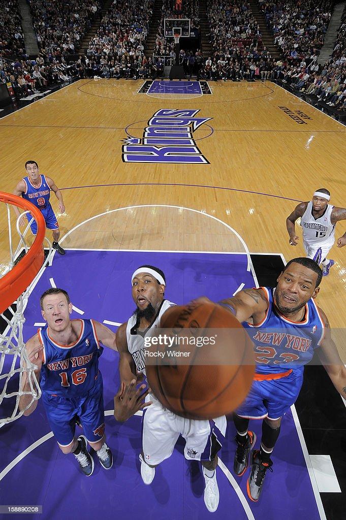 Marcus Camby #23 of the New York Knicks blocks the shot of John Salmons #5 of the Sacramento Kings on December 28, 2012 at Sleep Train Arena in Sacramento, California.