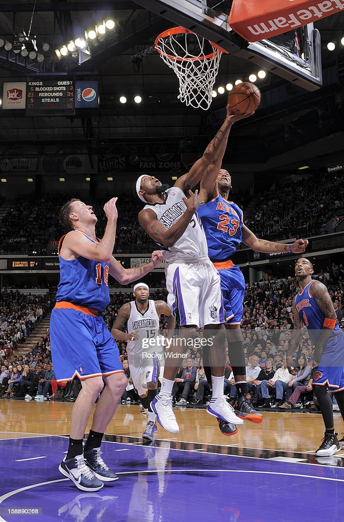 Marcus Camby #23 of the New York Knicks blocks the shot of John Salmons #5 of the Sacramento Kings on December 28, 2012 at Sleep Train Arena in Sacramento, California.