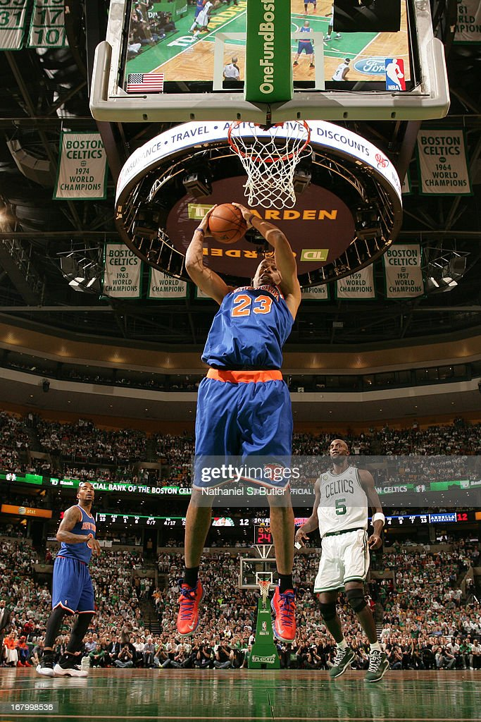 Marcus Camby #23 of the New York Knicks grabs a rebound against against the Boston Celtics in Game Six of the Eastern Conference Quarterfinals during the 2013 NBA Playoffs on May 3, 2013 at the TD Garden in Boston.