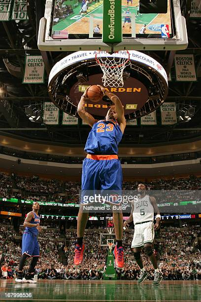 Marcus Camby of the New York Knicks grabs a rebound against against the Boston Celtics in Game Six of the Eastern Conference Quarterfinals during the...