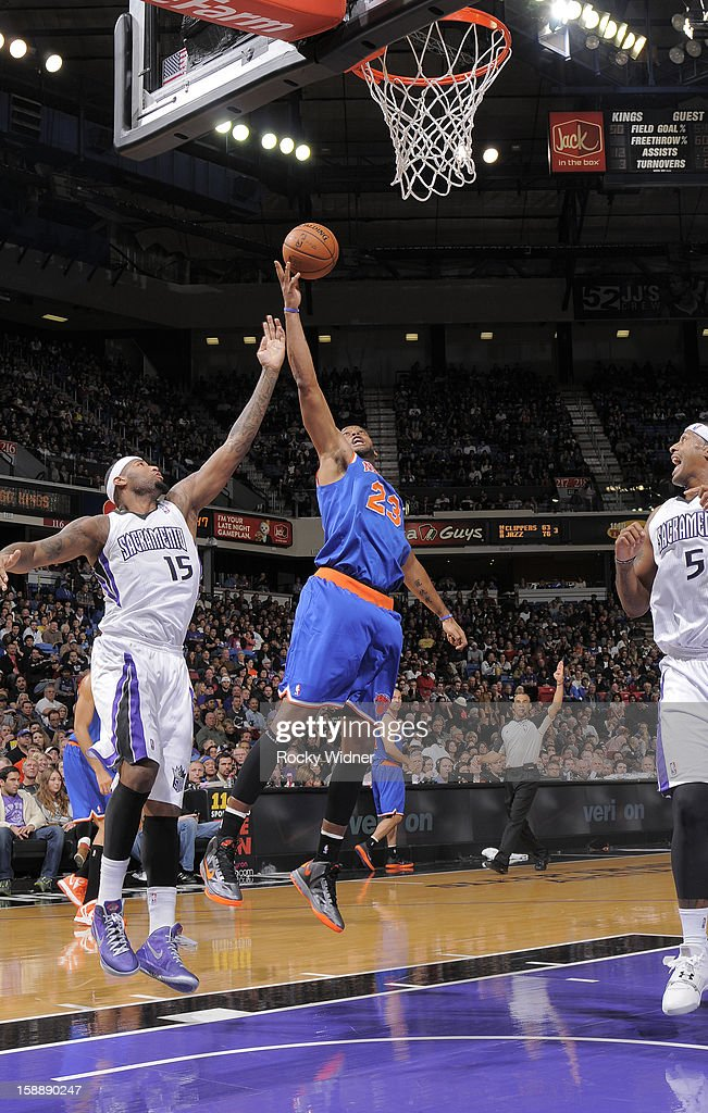 Marcus Camby #23 of the New York Knicks grabs the rebound against DeMarcus Cousins #15 of the Sacramento Kings on December 28, 2012 at Sleep Train Arena in Sacramento, California.