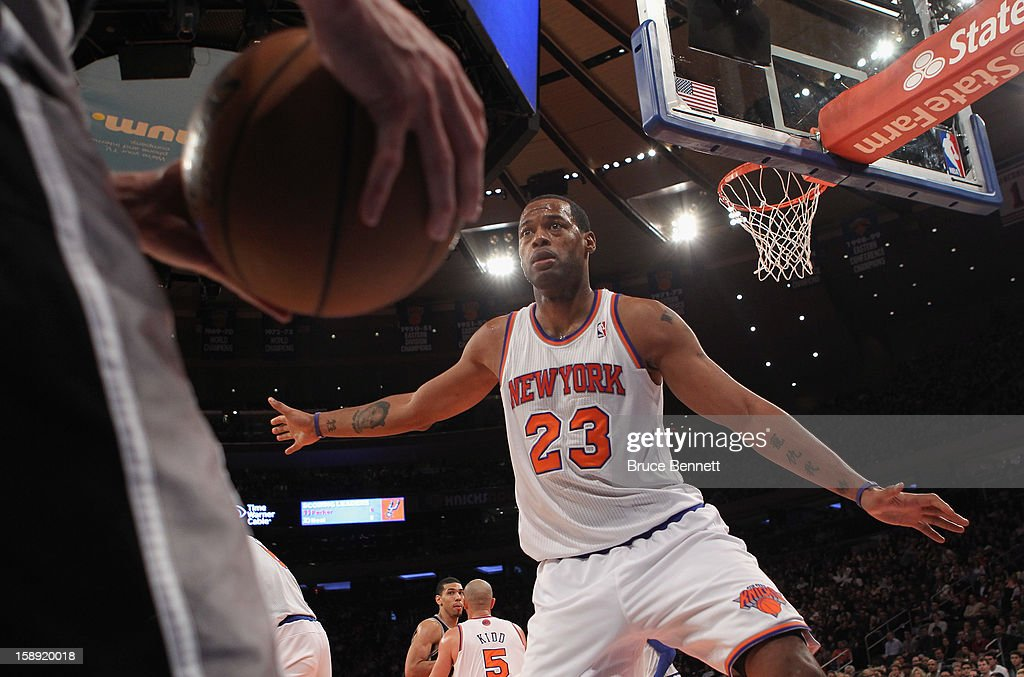 Marcus Camby #23 of the New York Knicks looks to block an in bound pass in the game against the San Antonio Spurs at Madison Square Garden on January 3, 2013 in New York City.