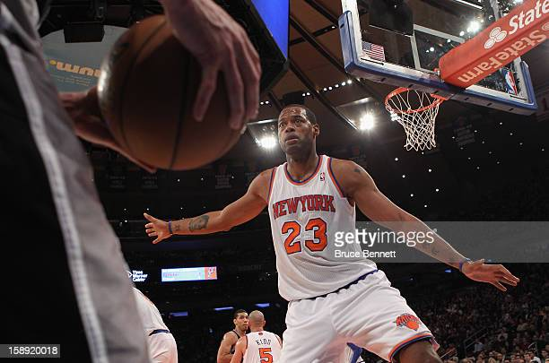 Marcus Camby of the New York Knicks looks to block an in bound pass in the game against the San Antonio Spurs at Madison Square Garden on January 3...